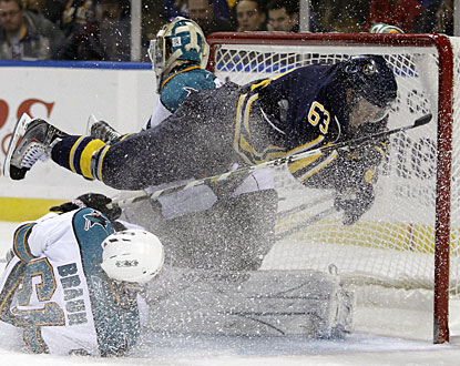 Buffalo's Tyler Ennis goes airborne after a big-time collision with Justin Braun in front of the net. (AP)