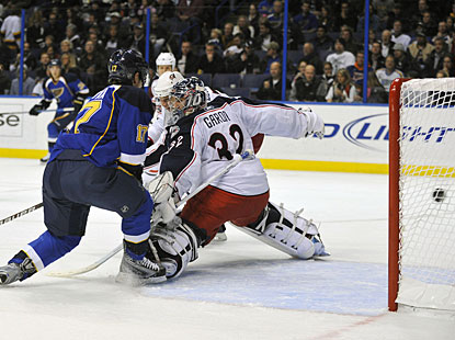 Vladimir Sobotka deflects the puck past Mathieu Garon for the Blues' third straight power-play goal. (US Presswire)