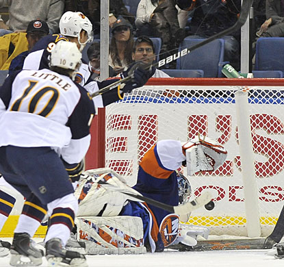 Goalie Rick DiPietro is unable to react quick enough to Bryan Little's wrist shot from close range. (AP)