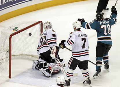 San Jose's Benn Ferriero (78) celebrates after Ryane Clowe's shot in overtime eludes Chicago goaltender Corey Crawford.  (AP)
