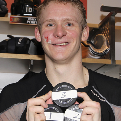 The Ducks' Corey Perry takes home the pucks that gave him his first career hat trick.  (Getty Images)