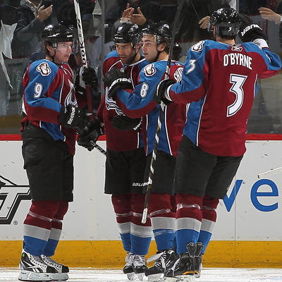 Matt Duchene is swarmed by his 'mates after scoring a goal late in the third to help Colorado rally back and defeat Chicago. (Getty Images)