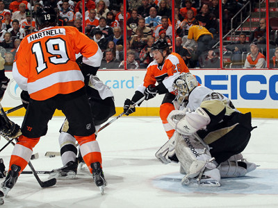 The Flyers' Claude Giroux (28) prepares to shoot the puck against goaltender Marc-Andre Fleury. (US Presswire)