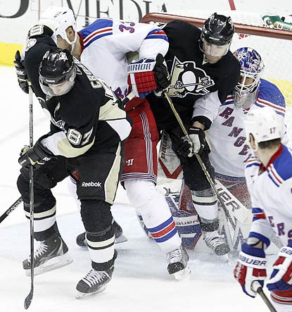 Pascal Dupuis makes contact with Rangers goalie Henrik Lundqvist, which disallows a game-tying goal by Sidney Crosby (left).  (AP)
