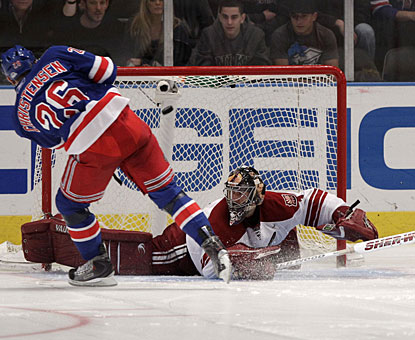 Erik Christensen goes top shelf on Jason LaBarbera for the only goal the Rangers need in the shootout. (AP)