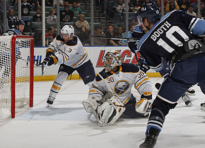 Neither Ryan Miller nor Jordan Leopold (3) can prevent the shot by David Booth from going into the net. (Getty Images)