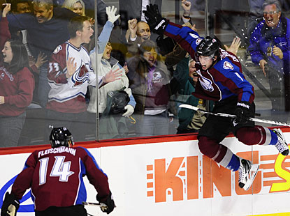 Matt Duchene leaps in the air to celebrate his winning goal with fans and teammate Tomas Fleischmann. (US Presswire)