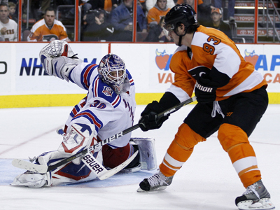 Nikolay Zherdev lifts the puck past Henrik Lundqvist to score his first of two goals against the Rangers.  (AP)