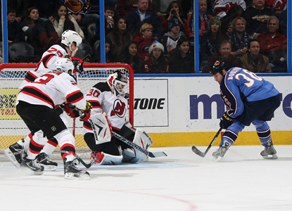 Eric Boulton flips the puck over Devils goalie Martin Brodeur's shoulder for one of his three goals. (Getty Images)