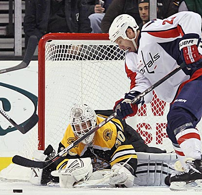 Tim Thomas makes one of his 39 saves to hold off the Capitals in a 3-2 Bruins' win. (Getty Images)