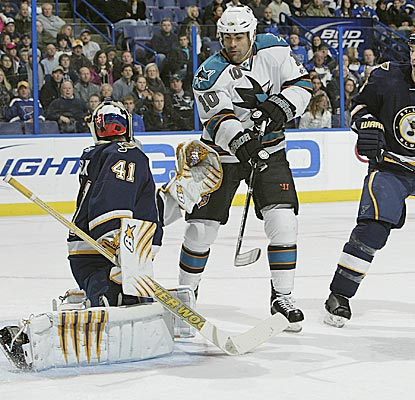 The Sharks' Jamal Mayers tries to flip a puck past Blues' goalie Jaroslav Halak in a 4-1 win. (Getty Images)