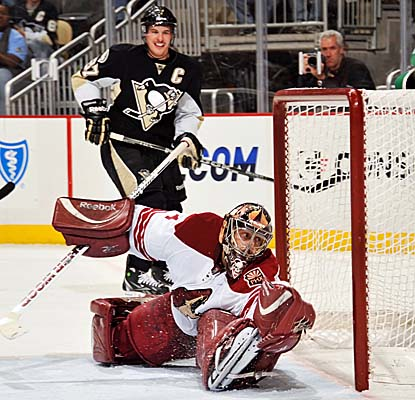 Jason LaBarbera can't stop a shot from Pens center Evgeni Malkin, whose five points help drive Pittsburgh's win. (Getty Images)