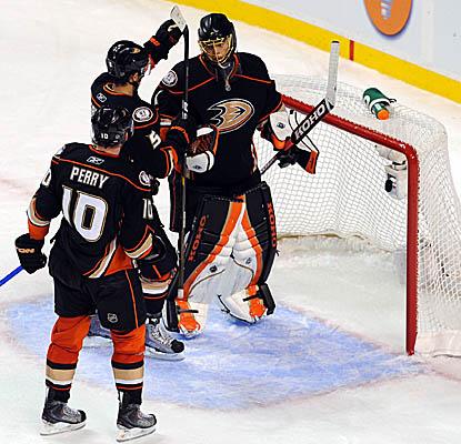 Fellow Ducks celebrate goalie Jonas Hiller's shutout Monday vs. the Bruins. (Getty Images)