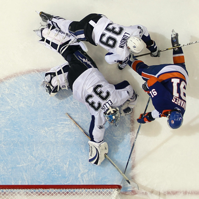 John Tavares scores the winning goal in overtime against Lightning goalie Dan Ellis. (Getty Images)