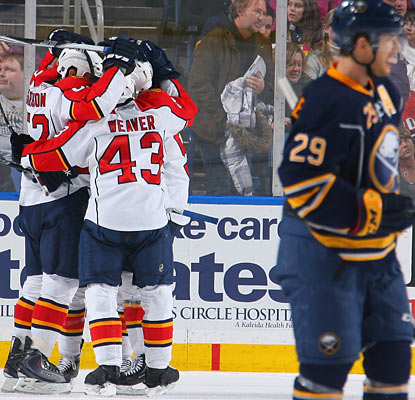 Jason Pominville of the Sabres can't bear to watch as Jason Garrison (left) celebrates his winning goal with teammates. (Getty Images)
