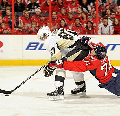 John Carlson and the Capitals can't hold off Sidney Crosby and the Penguins in a Winter Classic preview. (Getty Images)