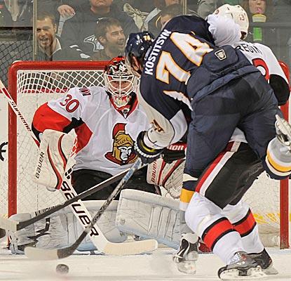 Ottawa goalie Brian Elliott eyes the shot of Sergei Kostitsyn to make one of his 25 saves. (Getty Images)