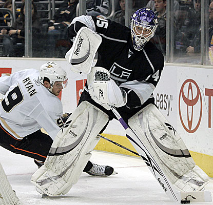 Kings goalie Jonathan Bernier, right, handles the puck as Anaheim's Bobby Ryan closes in. (AP)