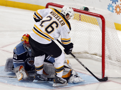 Blake Wheeler gives Boston the edge after inching this one past Scott Clemmensen in the shootout. (Getty Images)