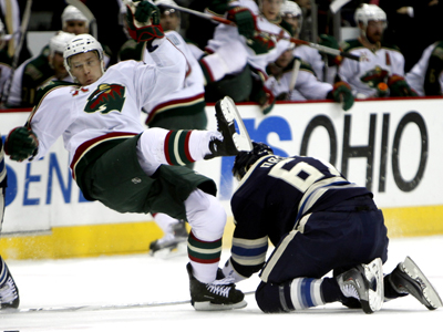 Rick Nash (right) plays solid defense while scoring two points and a SO goal against a frustrated Wild team.  (AP)