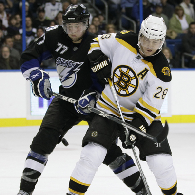 Mark Recchi (28) works against Victor Hedman before scoring the game-winner with 19.7 left in the third.  (Getty Images)