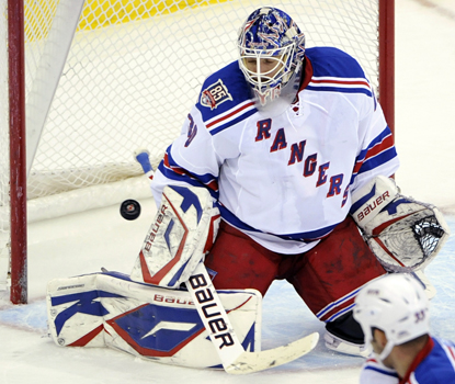 Rangers goalie Henrik Lundqvist makes one of his 43 stops in a 3-1 win over the Devils. (AP)