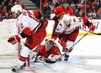 Eric Staal (12) and Sergei Samsonov (14) skate past goalie Brian Elliott and Chris Phillips as the puck goes in the net. (Getty Images)