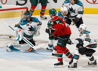 Kyle Brodziak of the Wild scores one of his two goals against Antero Niittymaki of the Sharks. (Getty Images)