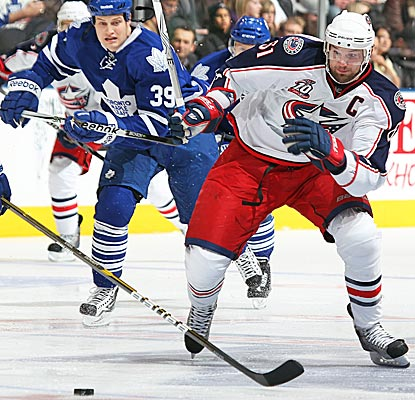 The Blue Jackets' Rick Nash chases down a puck against the Maple Leafs. Nash finishes with two assists in the win. (Getty Images)