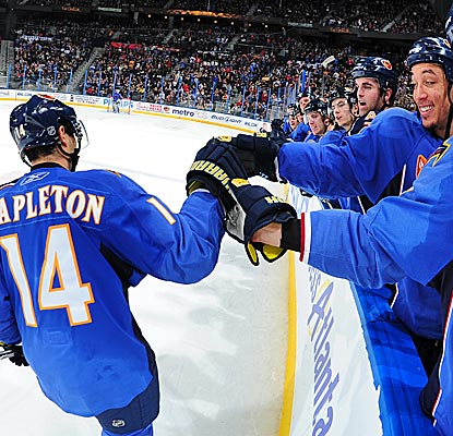 Tim Stapleton is congratulated by his Thrashers teammates after his goal in the shootout against the Bruins. (Getty Images)