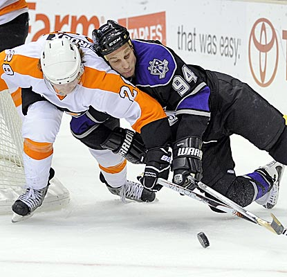 Flyers right wing Claude Giroux and Kings left wing Ryan Smyth battle for a loose puck during the second period. (AP)