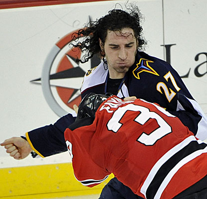 Atlanta's Chris Thorburn lands a right punch on New Jersey's Mark Fayne during the second period. (AP)