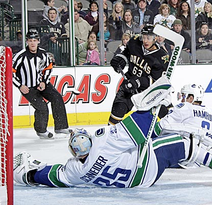 Canucks backup goalie Cory Schneider makes an acrobatic save against the Stars' Mike Ribeiro, finishing with 44 stops. (Getty Images)
