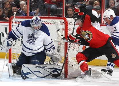 Jim O'Brien of the Senators attempts the wraparound shot as Leafs goalie James Reimer shuts the door. (Getty Images)