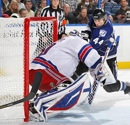 Nate Thompson is sitting on the doorstep to slam home the game-winning goal past Henrik Lundqvist.  (Getty Images)