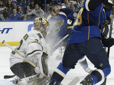 Kari Lehtonen handles a face full of ice during a 28-save win over the Blues. (Getty Images)