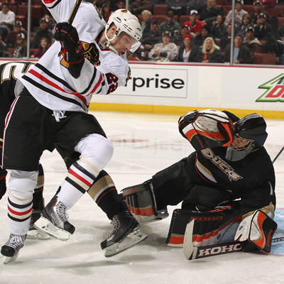 Jonas Hiller quickly moves to the ice in an attempt to draw a whistle and give the Ducks some breathing room.  (Getty Images)