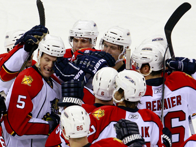 Bryan Allen is swarmed by his teammates after scoring the game-winning goal in OT.  (AP)