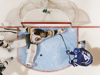 The Maple Leafs' Tyler Bozak (42) searches for the puck in front of a sprawling Tuukka Rask. (AP)