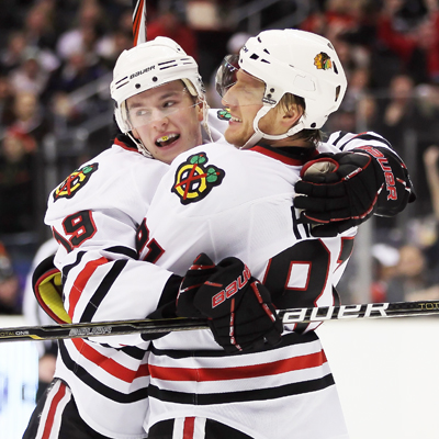 Jonathan Toews (left) celebrates his game-winning goal with teammate Marian Hossa.  (Getty Images)