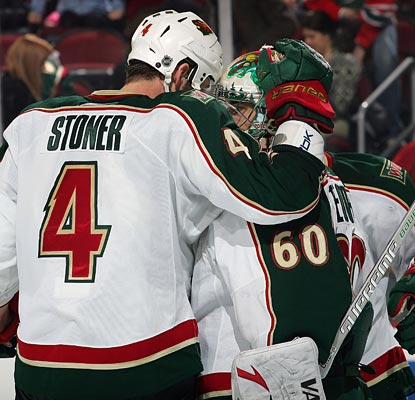 Rookie Clayton Stoner and Jose Theodore embrace after their performances help the Wild to a win.  (Getty Images)