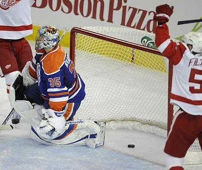 Valteri Filppula celebrates after Todd Bertuzzi's goal sneaks past Oilers goalie Nikolai Khabibulin.  (AP)