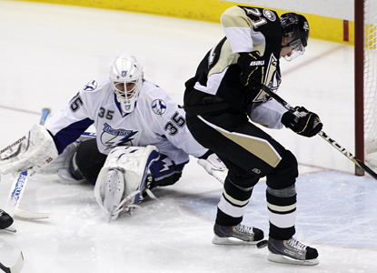 Evgeni Malkin controls the puck for a goal off the opening faceoff against Tampa Bay goalie Dwayne Roloson. (AP)