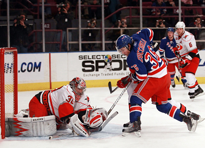 Cam Ward makes a stop on Mats Zuccarello in the second period but doesn't stop his overtime winner. (Getty Images)