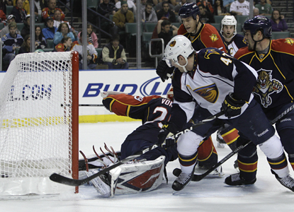 Atlanta's Rich Peverley (47) scores one of his two goals against Panthers goalie Tomas Vokoun. (AP)