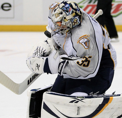 Pekka Rinne of the Predators makes one of his 40 saves against the Ducks. (AP)
