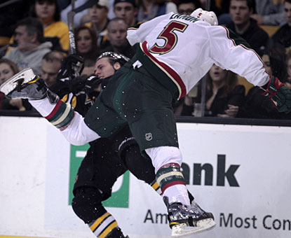 Wild defenseman Greg Zanon gets the better of the Bruins' David Krejci in this big collision. (AP)