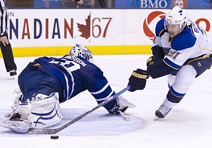 Jonas Gustavsson denies Patrik Berglund in the shootout in what is the game-winning save for Toronto. (AP)