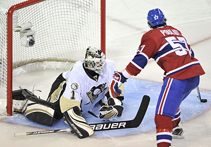 Benoit Pouliot fakes goalie Brent Johnson one way and handles the puck to the other side to push it into the net. (AP)