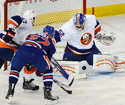 Gilbert Brule finds the space he is looking for to put the puck past goalie Nathan Lawson. (AP)